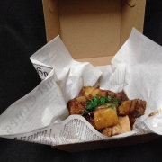 Caramelised pork belly in the takeaway container